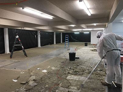 This carpet was subsequently removed and disposed of also. A further 40m2 of asbestos tiles were discovered, removed and bagged up by the end of the day.